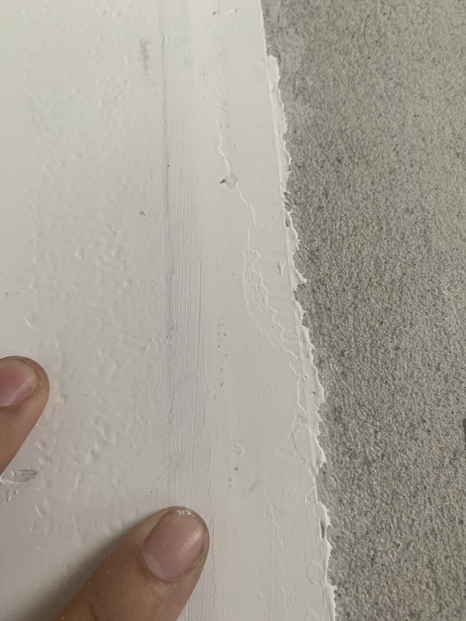 Nứt dọc khe nối tấm tường acotec và tường gạch, bê tông